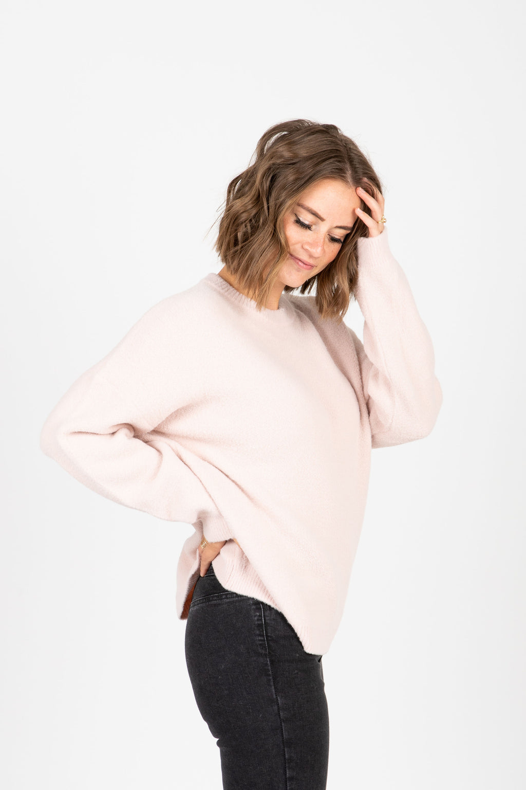 The Hawthorne Sweater in Soft Pink, studio shoot; side view