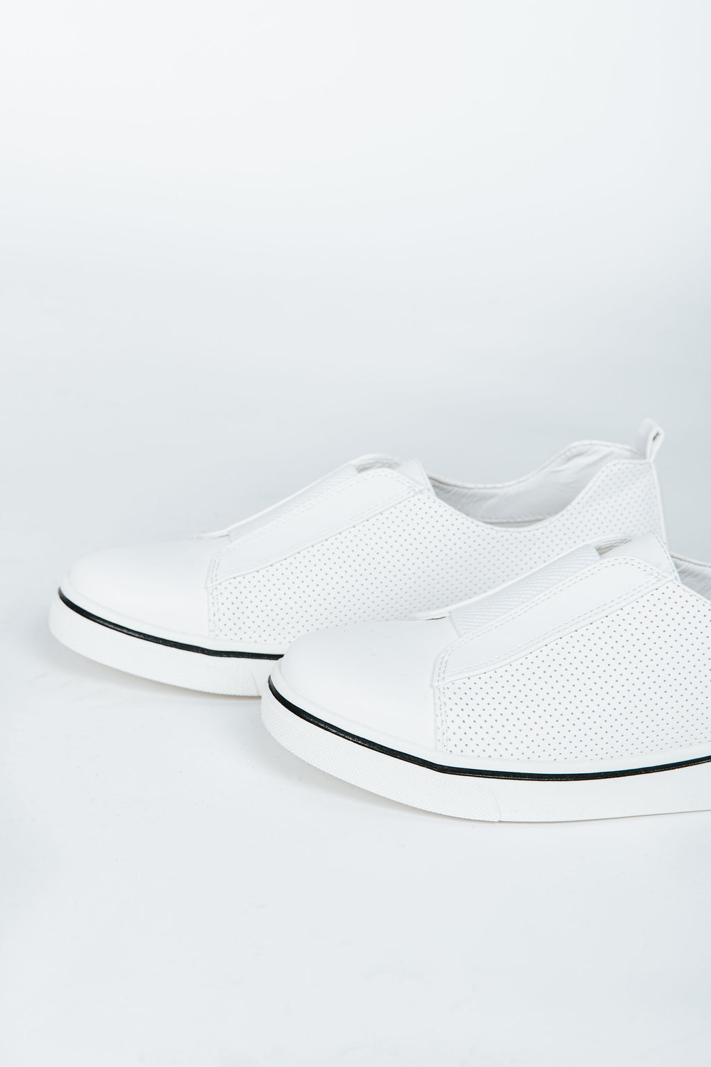 Malta Sneakers in White, studio shoot; side view