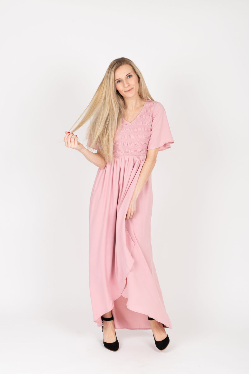 The Fancy Flutter Sleeve Dress in Blush, studio shoot; front view