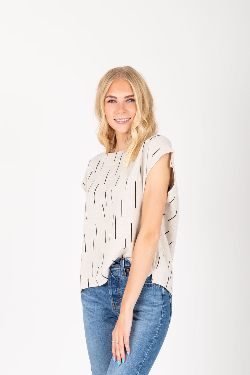 The Pepper Dash Linen Blouse in Natural, studio shoot; front view