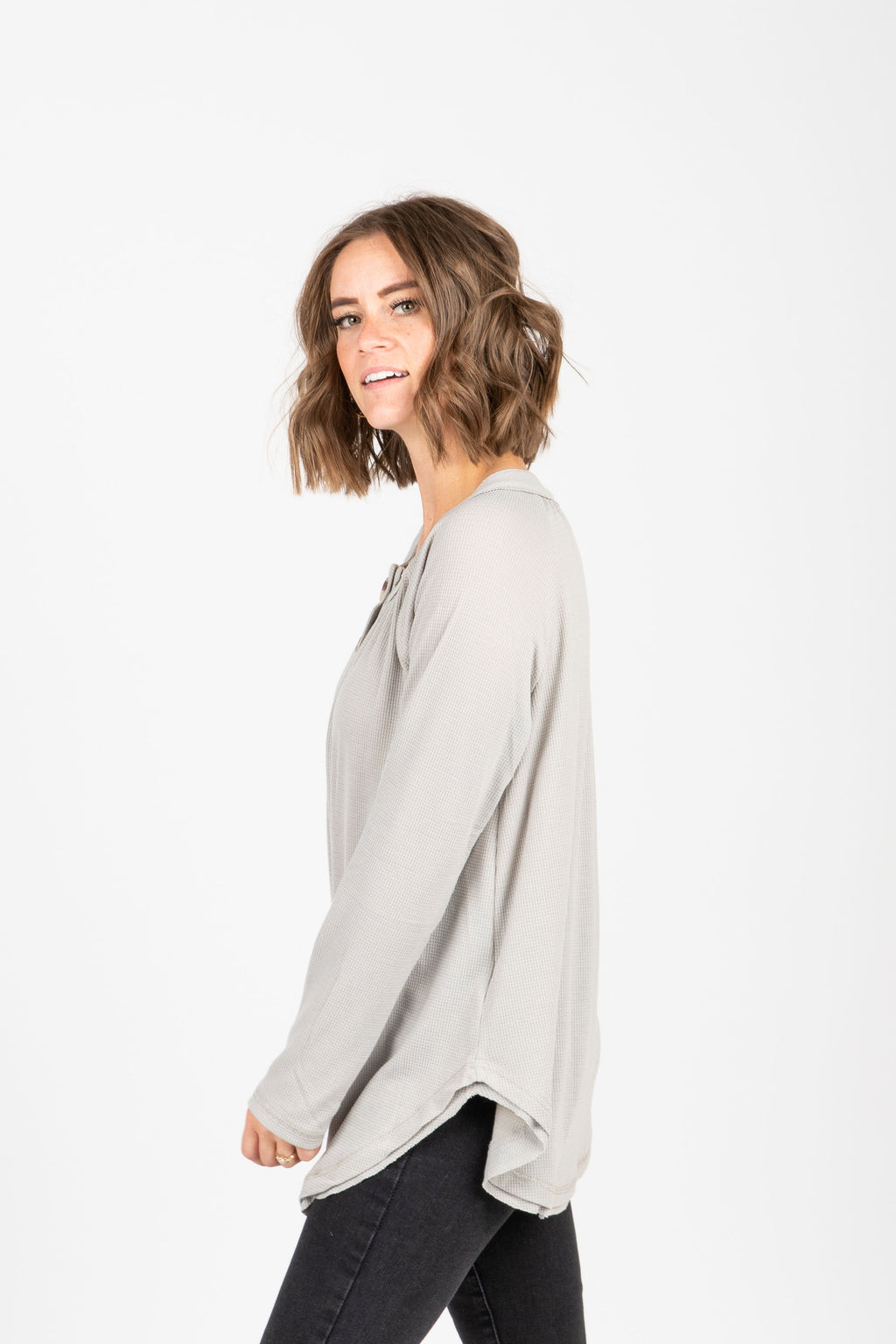 The Francine Button Casual Blouse in Stone, studio shoot; side view