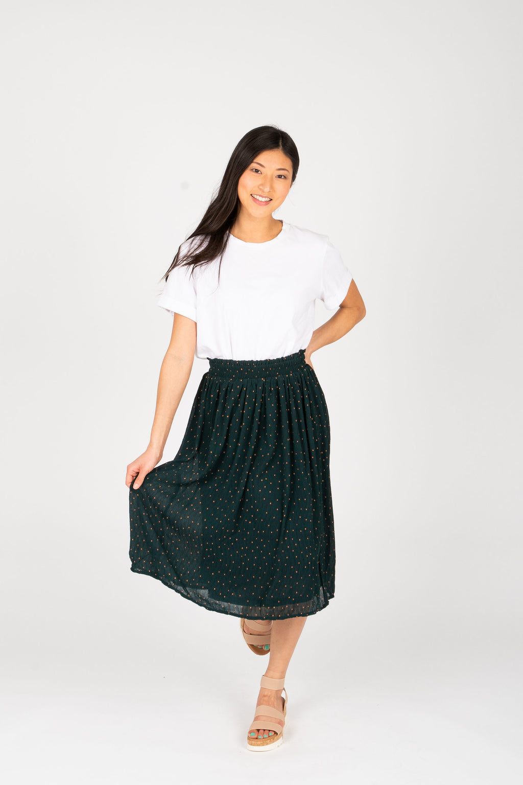 The Estelle Tiny Dot Skirt in Hunter Green, studio shoot; front view