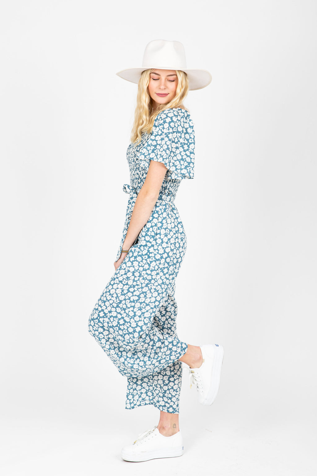 The Alicia Square Neck Jumpsuit in Blue Floral, studio shoot; side view