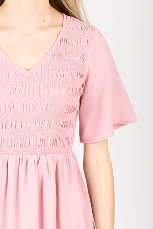 The Fancy Flutter Sleeve Dress in Blush, studio shoot; closer up front view