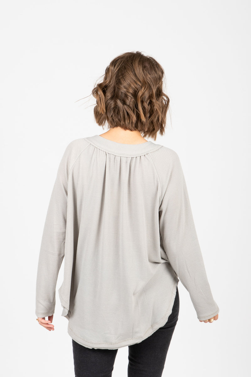 The Francine Button Casual Blouse in Stone, studio shoot; back view