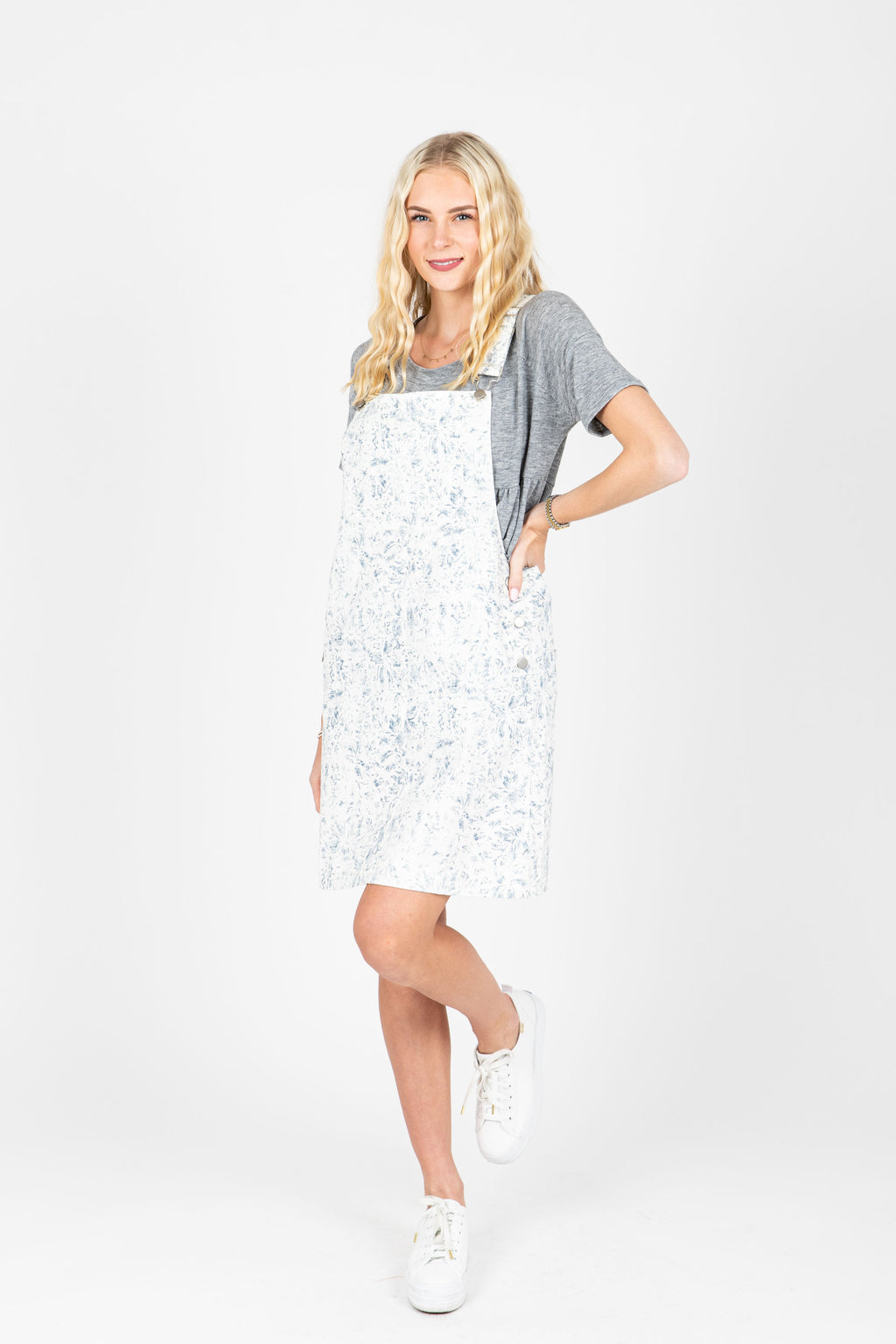 The Julia Patterned Jumper Dress in Blue, studio shoot; front view