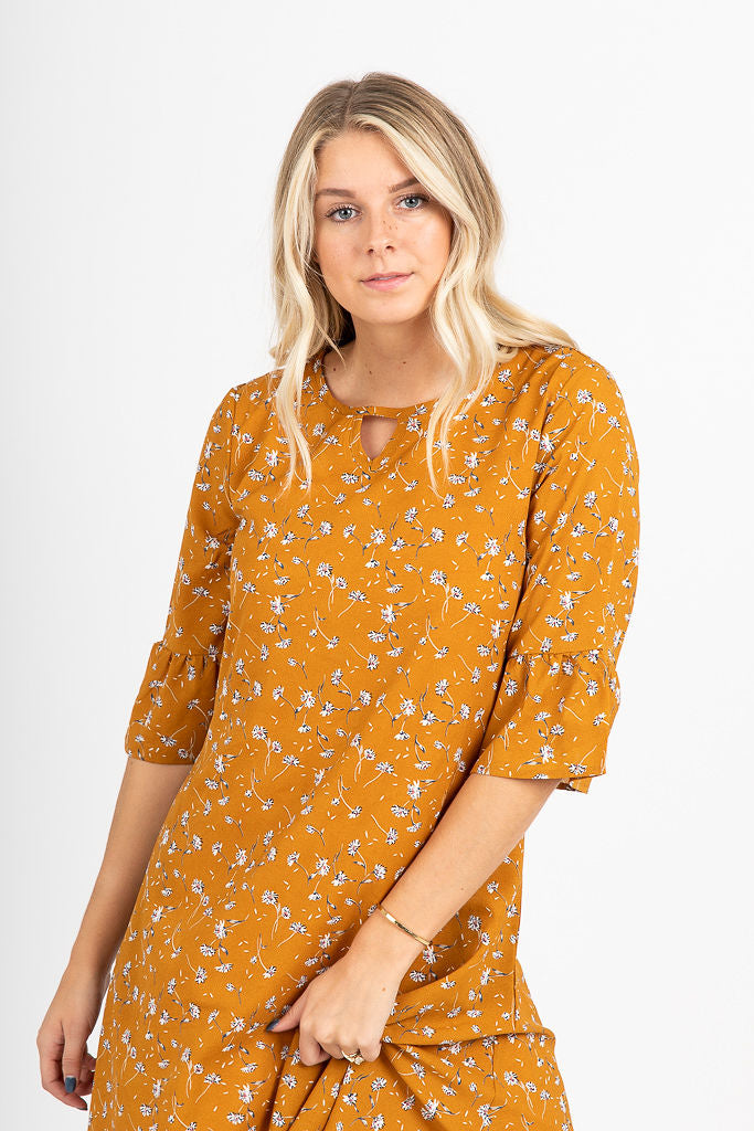 The Kenna Floral Swing Dress in Mustard