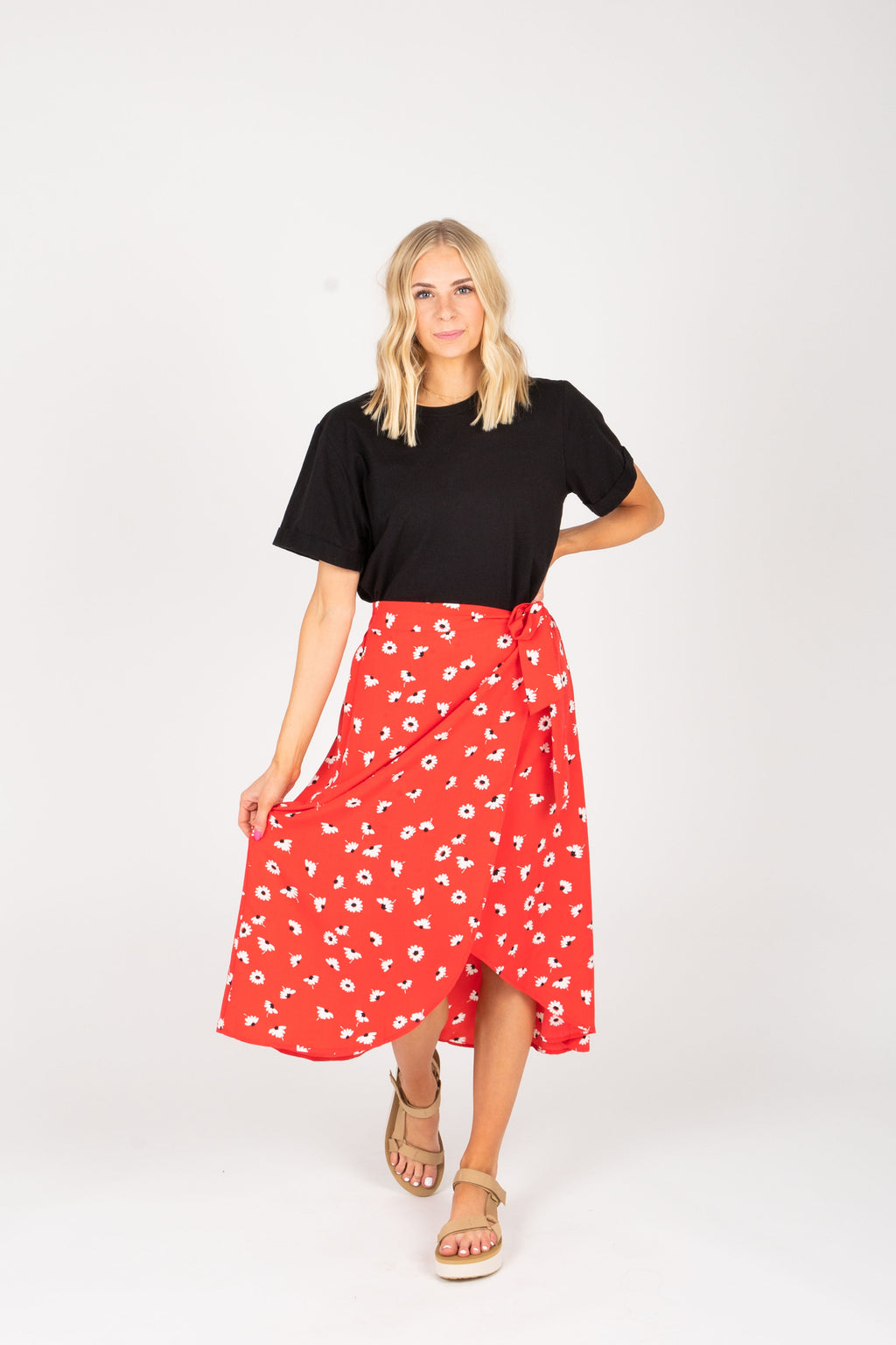 The Zoie Floral Wrap Skirt in Poppy, studio shoot; front view