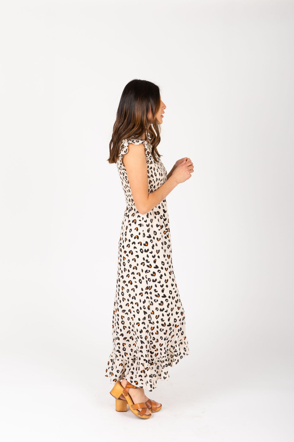 The Kylen Smocked Ruffle Dress in Animal Print, studio shoot; side view