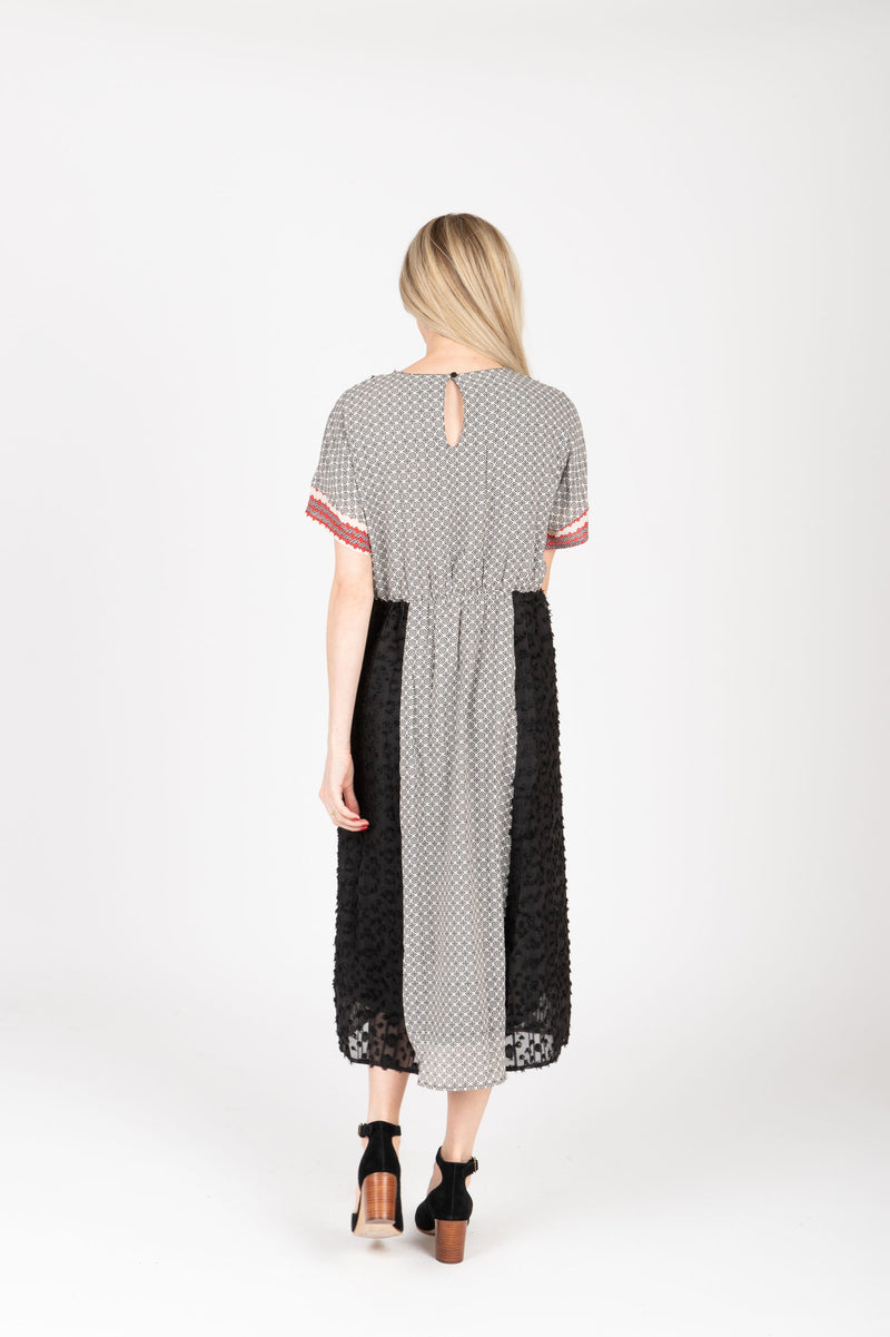 Piper & Scoot: The Jerry Trim Contrast Dress in Black, studio shoot; back view
