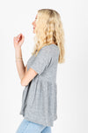 The Miller Peplum Top in Heather Grey, studio shoot; side view