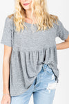 The Miller Peplum Top in Heather Grey, studio shoot; front view