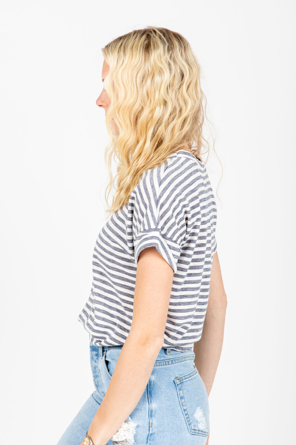 The Serena Striped Tee in Dusty Blue, studio shoot; side view