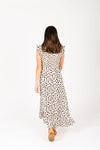 The Kylen Smocked Ruffle Dress in Animal Print, studio shoot; back view
