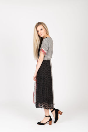 Piper & Scoot: The Jerry Trim Contrast Dress in Black, studio shoot; side view