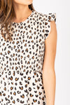 The Kylen Smocked Ruffle Dress in Animal Print, studio shoot; front view
