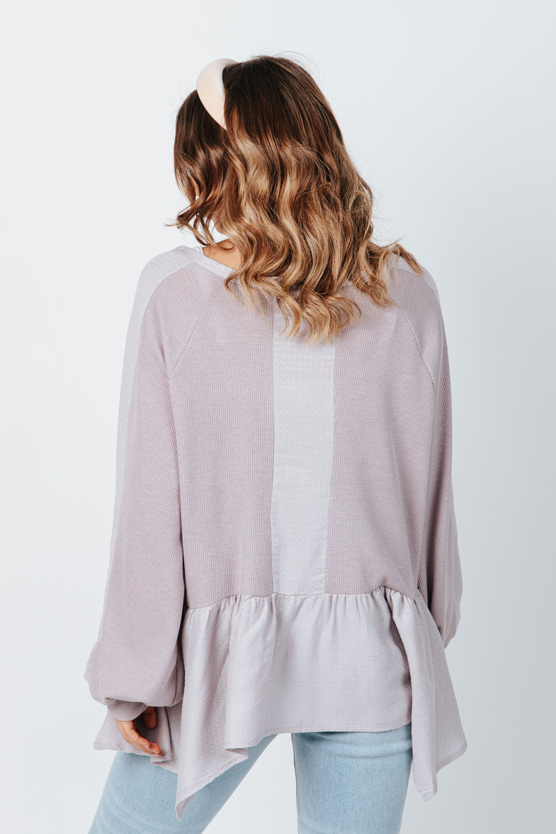 The Clive Peplum Blouse in Lavender, studio shoot; back view