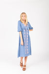 The Vallarta Embroidered Midi Dress in Dusty Blue, studio shoot; front view