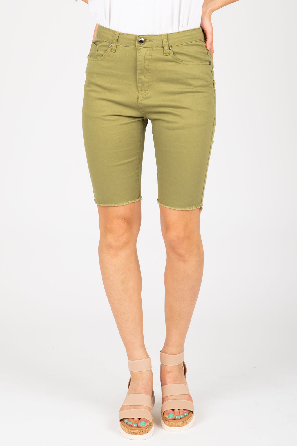 The Stretch Denim Biker Short in Olive, studio shoot; front view