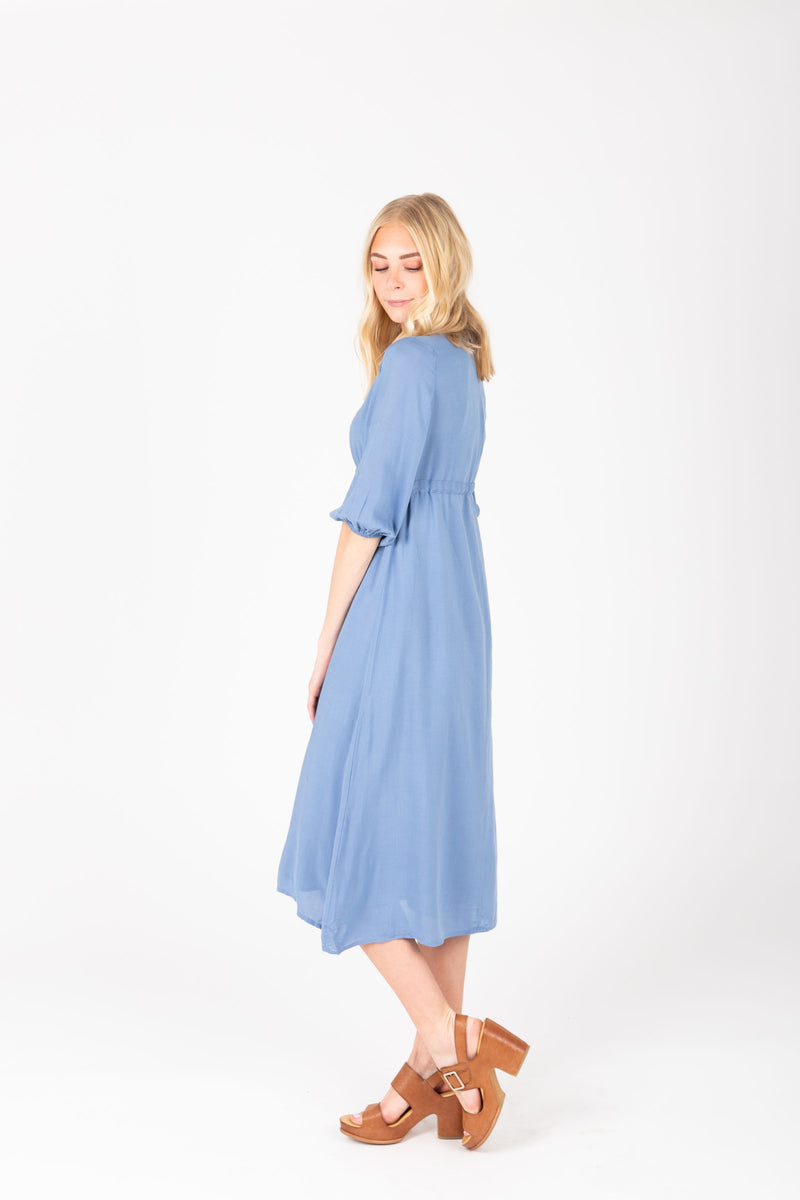 The Vallarta Embroidered Midi Dress in Dusty Blue, studio shoot; side view