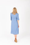 The Vallarta Embroidered Midi Dress in Dusty Blue, studio shoot; back view