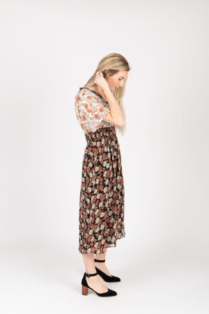 Piper & Scoot: The Bay Floral Contrast Dress in Black, studio shoot; side view