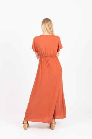 The Walsh Embroidered Maxi Dress in Rust, studio shoot; back view