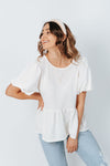 The Bailey Babydoll Blouse in Ivory, studio shoot; front view