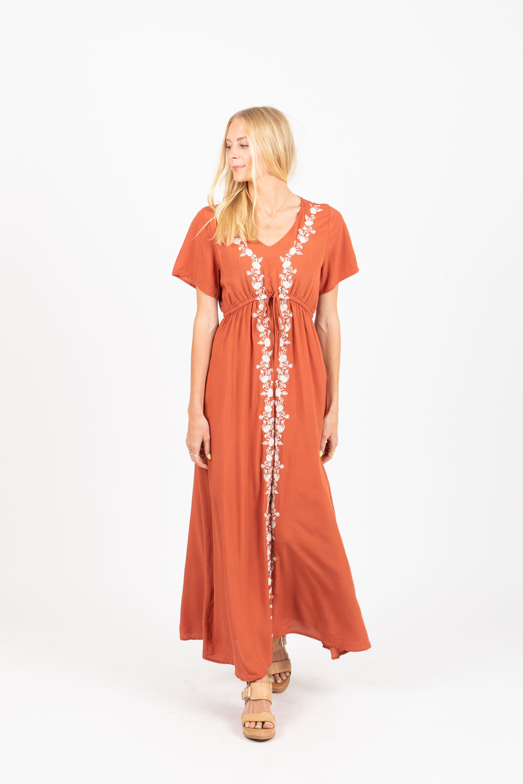 The Walsh Embroidered Maxi Dress in Rust, studio shoot; front view