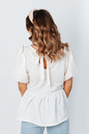The Bailey Babydoll Blouse in Ivory, studio shoot; back view