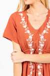 The Walsh Embroidered Maxi Dress in Rust, studio shoot; closer up front view