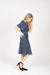 Piper & Scoot: The Marleigh Floral Wrap Dress in Navy, studio shoot; side view