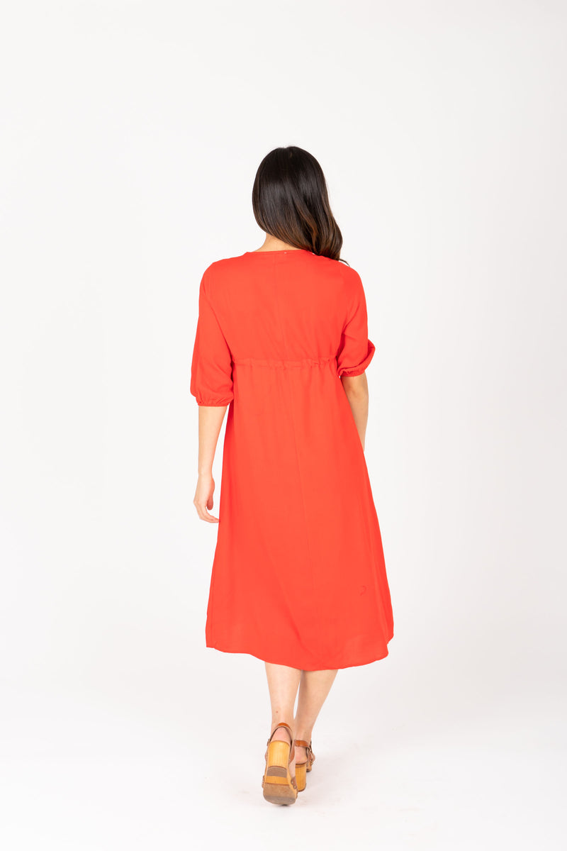 The Vallarta Embroidered Midi Dress in Poppy, studio shoot; back view