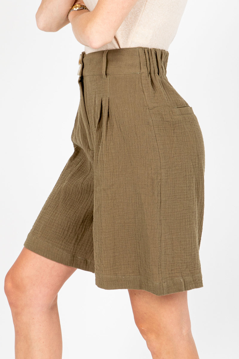 The Berry High Rise Short in Olive, studio shoot; side view