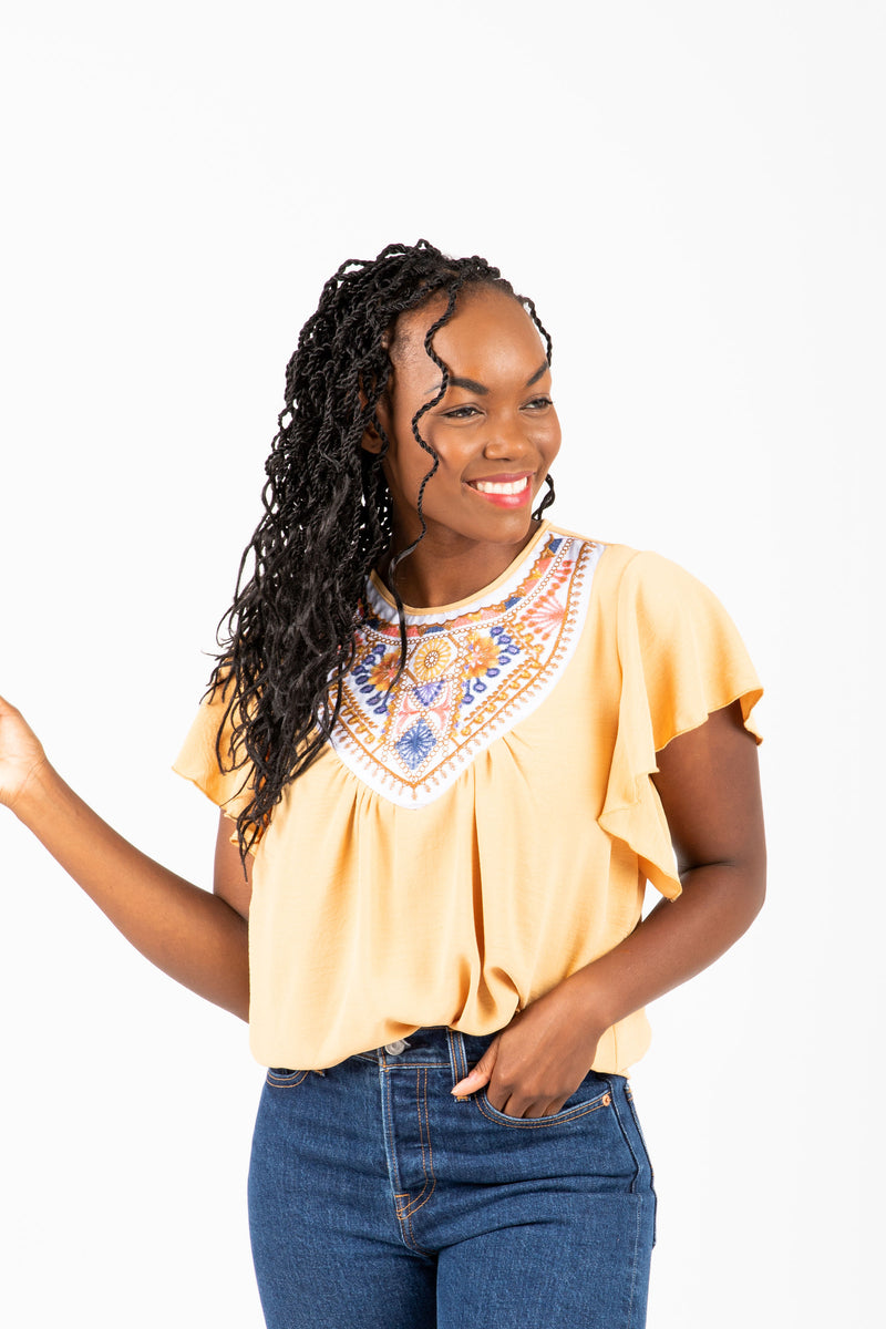 The Drake Embroidered Blouse in Mustard, studio shoot; front view