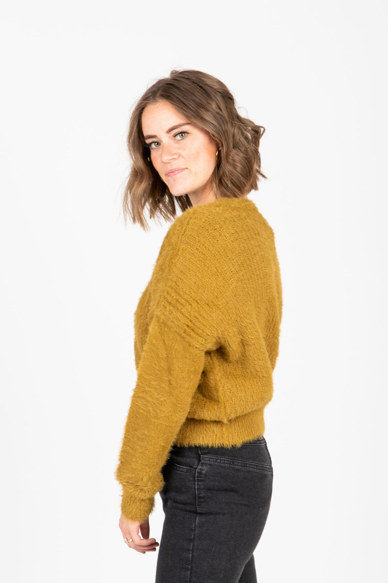 The Yardley Cozy Button Cardigan in Moss, studio shoot; side view
