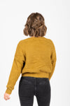 The Yardley Cozy Button Cardigan in Moss, studio shoot; back view