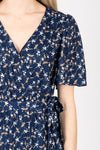 Piper & Scoot: The Marleigh Floral Wrap Dress in Navy, studio shoot; closer up front view