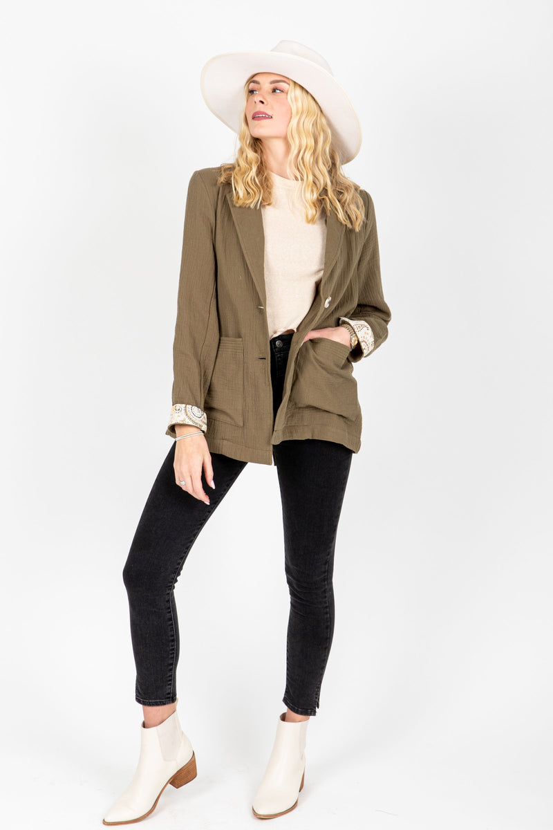 The Halle Relaxed Button Up Blazer in Olive, studio shoot; front view