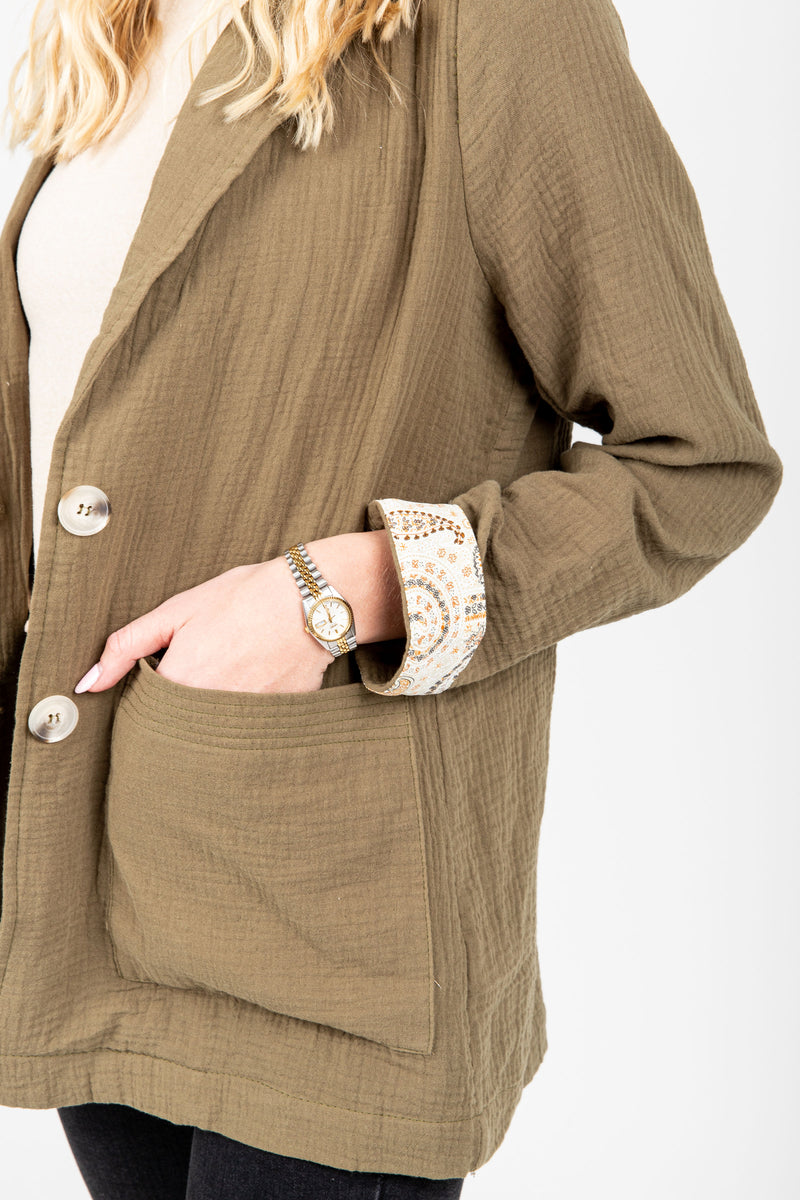 The Halle Relaxed Button Up Blazer in Olive, studio shoot; side view