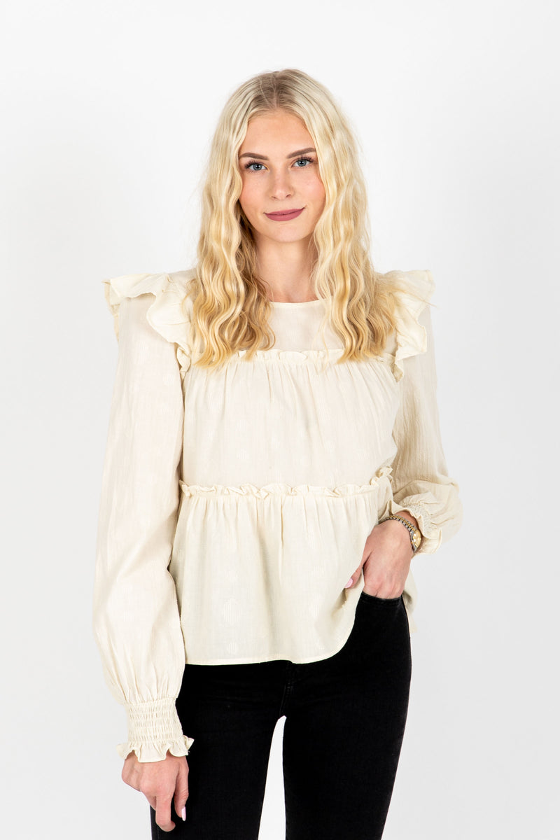 The Emilia Ruffle Detail Blouse in Cream, studio shoot; front view