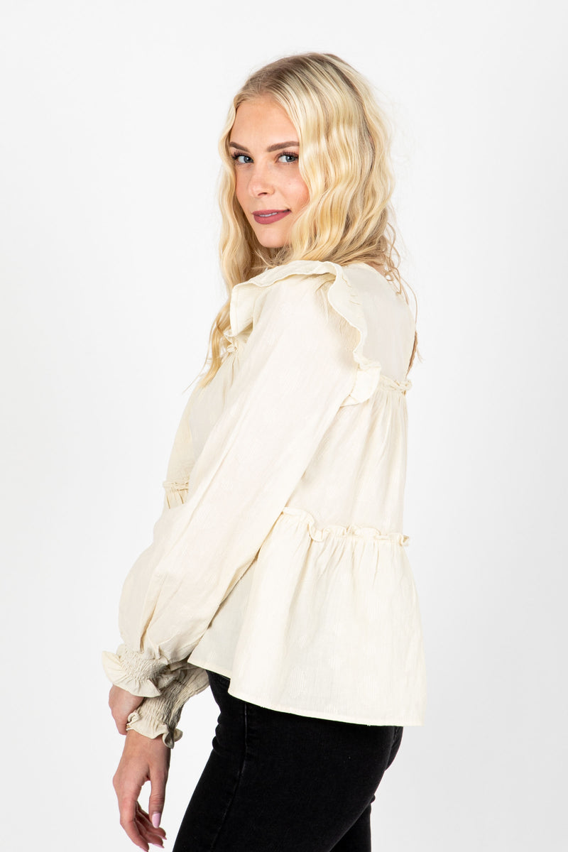 The Emilia Ruffle Detail Blouse in Cream, studio shoot; side view