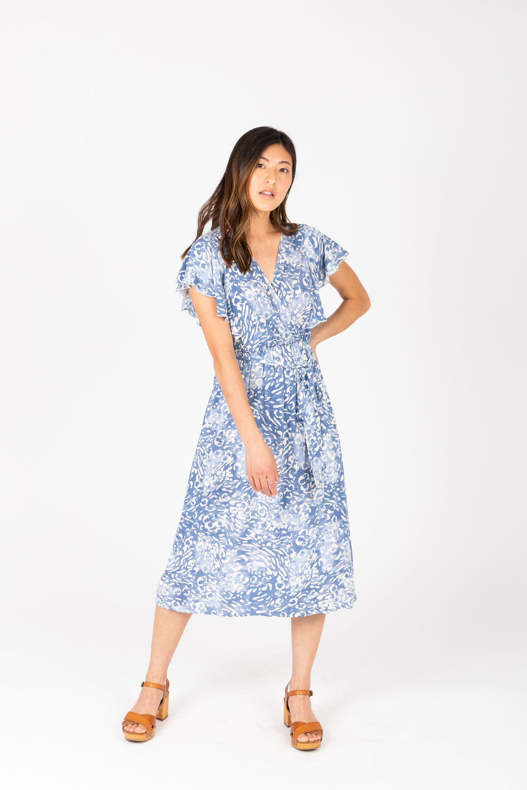 The Juliette Patterned Wrap Dress in Blue, studio shoot; front view