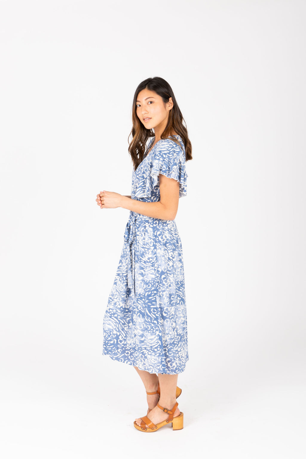 The Juliette Patterned Wrap Dress in Blue, studio shoot; side view