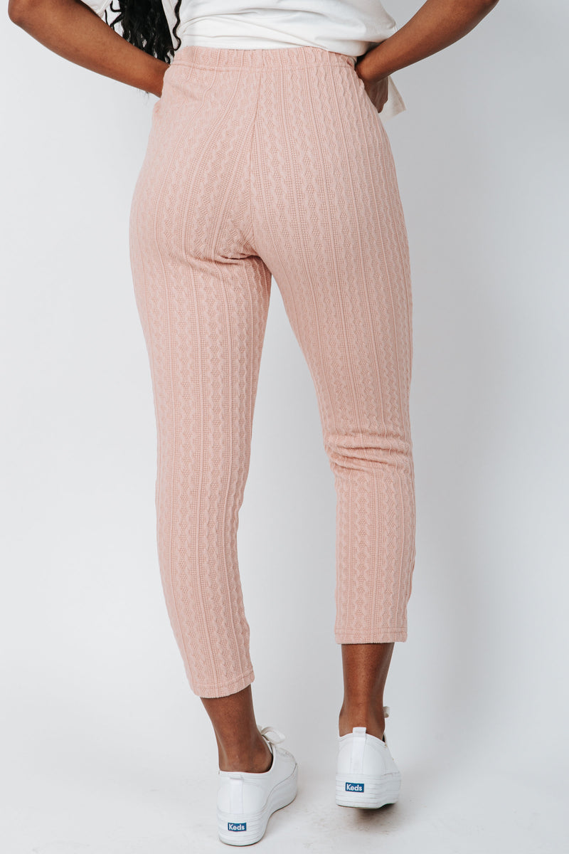 The McGuire Knit Pant in Dusty Pink, studio shoot; back view