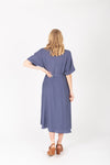 The Benton Button Midi Dress in Indigo, studio shoot; back view