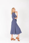 The Benton Button Midi Dress in Indigo, studio shoot; side view