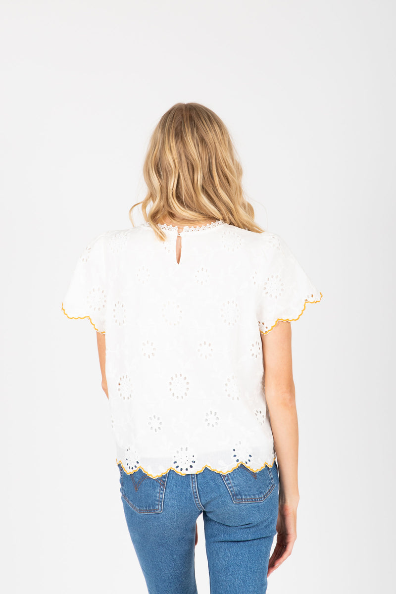 The Alessia Embroidered Scallop Blouse in White, studio shoot; back view