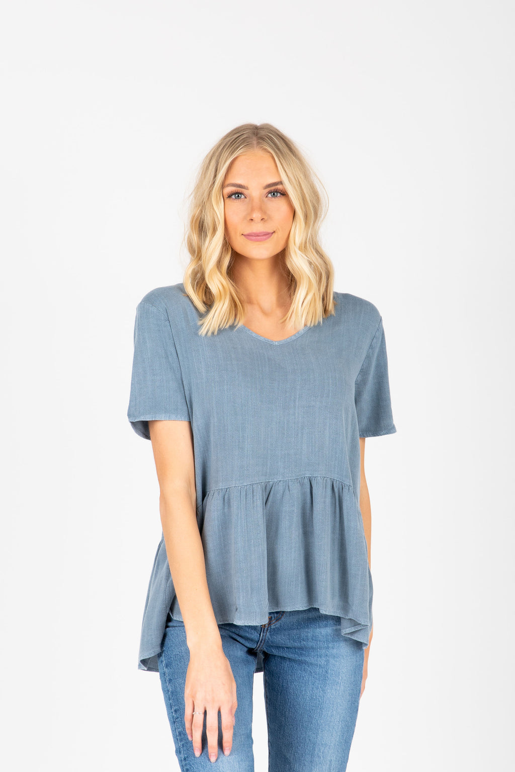 The Jayda Peplum Blouse in Chambray, studio shoot; front view