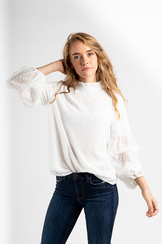 348848f636430e The Fonda Swiss Blouse in White.   42.00. The Swan Patterned Peplum ...
